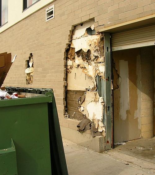 Picture of damaged brick around loading dock door.