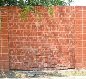 picture of sagging brick fence Panel