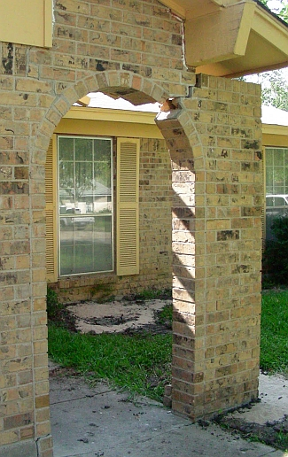 Broken brick arch sitting on inadequate foundation