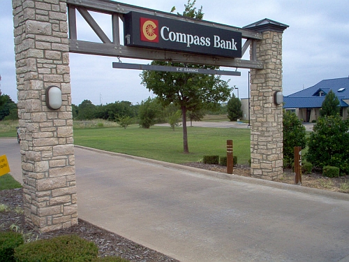picture of bank sign on stone columns