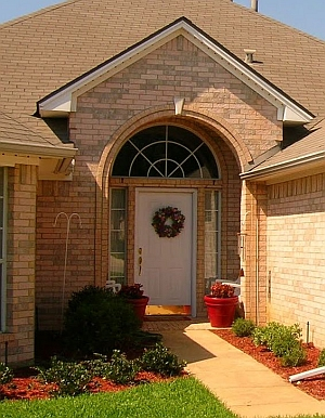 Beautiful parabolic brick front entry.