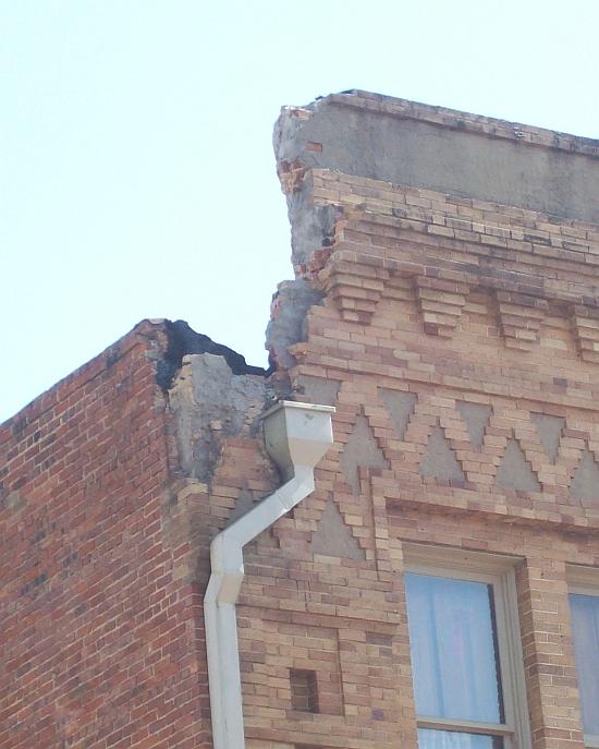 Stockyards Hotel damaged brick parapet.