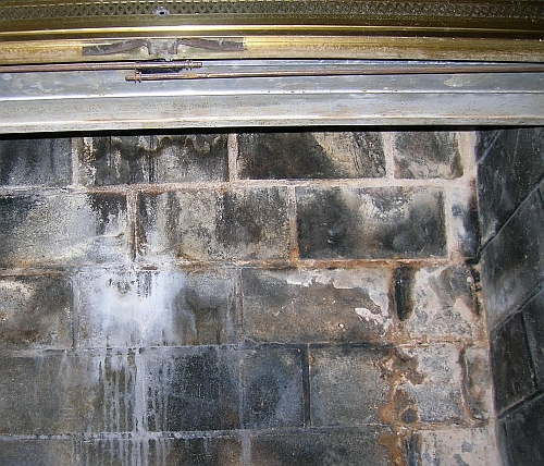 Picture of Water infiltration stains in brick firebox.
