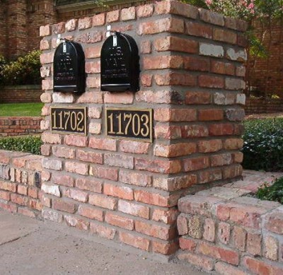 Double Brick Mailbox with Brass Plates Tucked into Brick Landscaping Wall