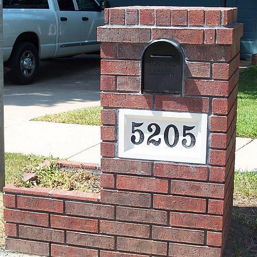 A brick planter box built with a brick mailbox